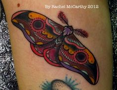 A colourful Emperor moth tattoo by Rachel McCarthy.