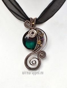Teal and purple steampunk wire wrapped necklace - I love this wire work!!
