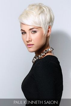 Platinum strands perfectly intensify a shapely short cut, accentuating the model's striking features and the fairness of her skin tone.