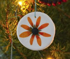 Turn pressed flowers into gorgeous homemade Christmas ornaments! What a great idea! | AllFreeKidsCrafts.com