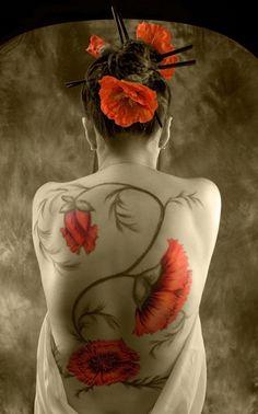 Poppy body art.