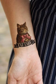Show off your love for kitties with this adorable cat lady (temporary) tattoo.