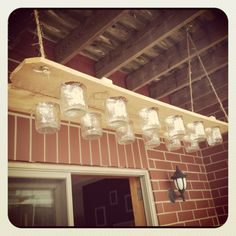 A mason jar chandelier can help brighten up an outdoor patio space.