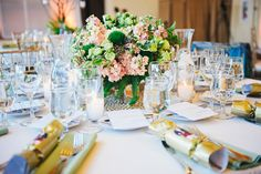 Green and soft pink centerpieces are a great springtime accent.