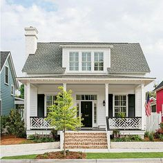 A lovely white cottage in Midtown Square, Beaufort, South Carolina. | Best Planned Community Winner | SouthernLiving.com