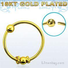 18K gold - Oro 18 kilates. Nose piercing - Piercing de nariz.