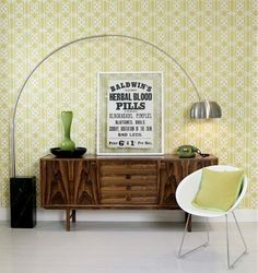 wallpapered accent wall. green.