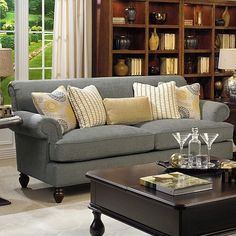 Dark gray couch with colorful pillows