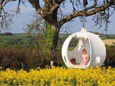 Roomoon, A Spherical Luxury Hanging Tent With a Steel Frame and Pine Wood Floor