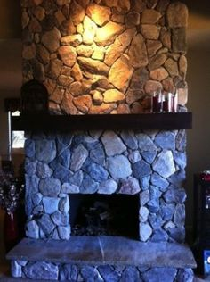 This member wrestled with her stone fireplace and in the end installed dark wood mantle.