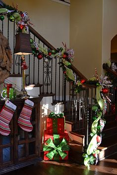 garland and also the gifts stacked beside staircase
