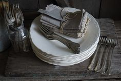 White dishes, linen napkins and silver flatware