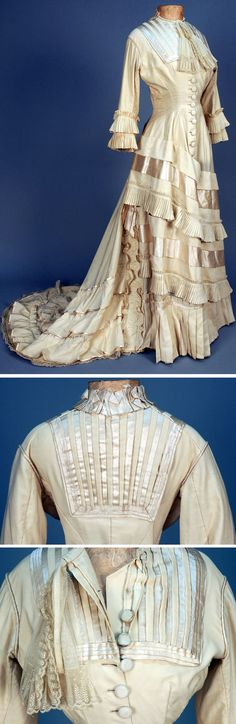Wedding dress ca. 1877. One-piece ivory wool. Short sleeves with pleated self-ruffles, satin and wool striped yoke, button front, trained skirt decorated with diagonal bands of wool, satin and pleated ruffles. Hem has deep flounce of wider ruffles, partial cotton lining and facings. Whitaker Auctions