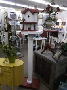 $125 - Large white bird house with red trim and bird. great piece for the garden.  ***** In Booth C5 at Main Street Antique Mall 7260 E Main St (east of Power RD on MAIN STREET) Mesa Az 85207 **** Open 7 days a week 10:00AM-5:30PM **** Call for more information 480 924 1122 **** We Accept cash, debit, VISA, MasterCard or Discover.