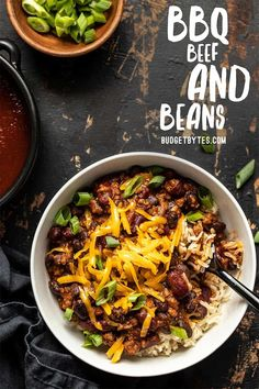 Serve these sweet, tangy, and savory BBQ Beef and Beans with rice and cheese for a simple and comforting weeknight dinner the whole family will love. Budgetbytes.com #beans #weeknightdinner