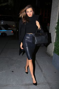 Miranda Kerr in a Givenchy coat and Gianvito Rossi pumps with an Hermes bag