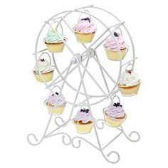 "Cupcake holder in a ferris wheel shape. Holds eight cupcakes.  Product: Cupcake holderConstruction Material: EnamelColor: WhiteFeatures:  Holds eight cupcakesRemovable holders Dimensions: 18.75"" H x 13.5"" W x 7.75"" D Cleaning and Care: Wipe with soft cloth"