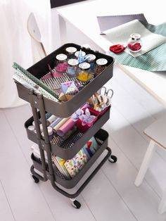 A cart with wheels provides great storage and easy transportation for things that aren't always done in the same room, like sewing, playing, or cooking.