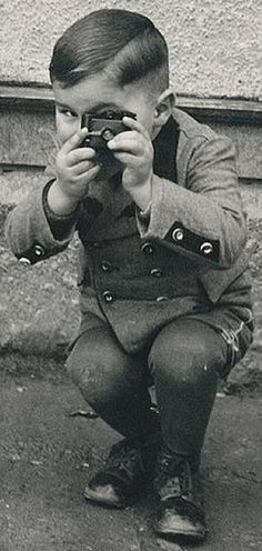 A young photographer plays camera tag