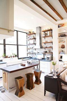 painted white floor, black framed windows, open shelving
