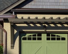 Pergola over garage doors- maybe add some pretty flowering vines!!