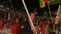 Team GB: Sailing gold medal winner Ben Ainslie proudly carries the British flag into the Olympic Stadium