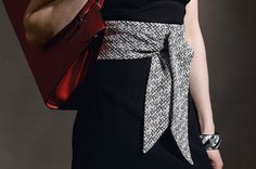 For tying together any look, I love to quickly stitch up a wide, obi-wrap belt. It's super-quick to sew, and since it takes so little fabric, it's a great way to use those pricey drop-dead-gorgeous fabrics you've been drooling over. This belt makes a smart choice for defining the waistline and lends drama to every look from a cocktail dress to a simple T-shirt and jeans.