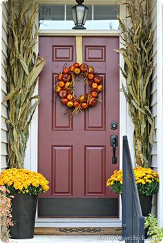 Corn stalks on the porch for a beautiful Fall look. It gives so much dramatic height!