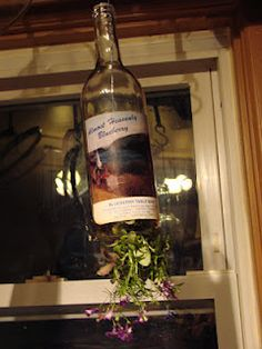 Hanging wine bottle planter