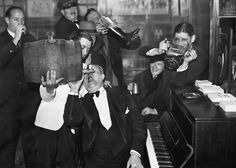 Americans in Paris on the night of repeal: Scene at the American Bar as a group of visitors from the U.S. celebrated the passing of Prohibition in their homeland in a real two-fisted manner.