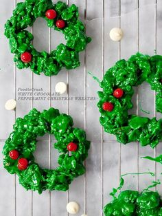 Package a few of these colorful cookies for tasty office gifts! White Chocolate and Peppermint Christmas Wreath Cookies from foodiecrush.com