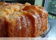 ORANGE JUICE CAKE: 1 box of yellow cake mix, 1 small box of orange gelatin,  1 cup orange juice (the kind you drink),  3/4 cup oil, 4 eggs, and 2-3 teaspoons orange zest.  Orange Glaze: 1 cup powdered sugar, 3 tablespoon orange juice, and 1 teaspoon orange zest.
