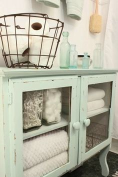 Turn a piece of furniture into a bathroom organization command center for all of your bathroom necessities like towels, toilet paper, q-tips, and so much more!