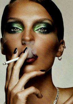 Creamy Green Smokey Eyes, Blood Red Glitter Lips, and a Cigarette. Editorial Makeup.