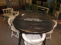 "SOLD -  Round Shabby Chic ""Gather Together"" table w/Leaf & 6 chairs. Painted black with cream chair and distressed to give it that shappy chic look. ***** In Booth D15 at Main Street Antique Mall 7260 E Main St (east of Power RD on MAIN STREET) Mesa Az 85207 **** Open 7 days a week 10:00AM-5:30PM **** Call for more information 480 924 1122 **** We Accept cash, debit, VISA, MasterCard or Discover."