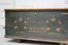large antique blanket chest with original hand painted floral folk art 1800s. via Etsy.
