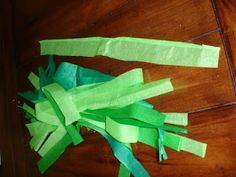 Grass Skirts - use plastic table cloths from dollar store