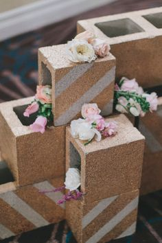 painted cinder blocks as decor, photo by Rad + In Love http://ruffledblog.com/kona-kai-resort-wedding #weddingideas #diy #gold