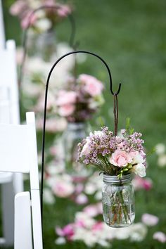 love the simple hanging flowers to decorate the aisle