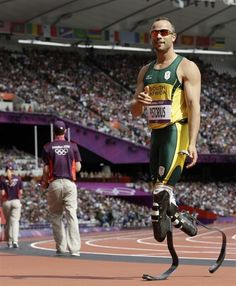 South Africa's Oscar Pistorius reacts after competing in a men's 400-meter heat during the athletics in the Olympic Stadium.