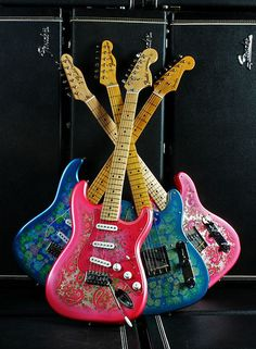Original and Reissued Fender Strats & Teles with the Pink Paisley and Blue Flowers finish.