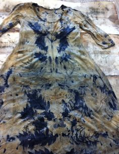 a white dress that had been left in a river, then, using plants and herbs, and-dyed by fibre artist India Flint