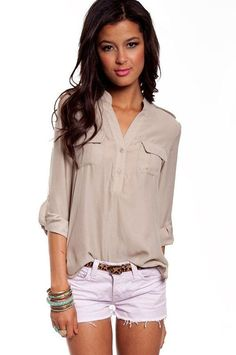 Thinking navy blouse in this style with nude belt. Longer shorts.