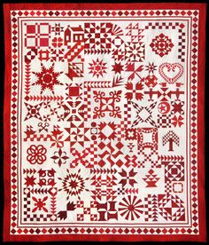 """Red and White - By the Numbers"" by Barbara Black was selected as the Commemorative Quilt to celebrate the 40th anniversary of the International Quilt Festival. (2014).  Barbara used 59 different fabrics and there are 2770 pieces. Quilted by Pam Dransfeldt.  Posted by Sue Garman."