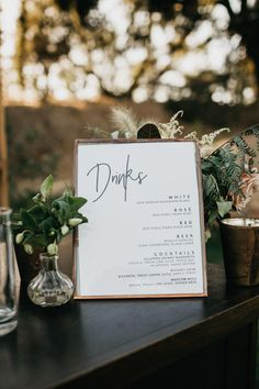 Elegant black + white bar signage at this cozy reception | Image by Nicole Leever Photography