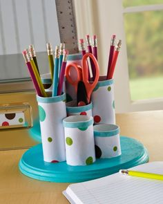 Make a desk organizer from a plaque and paper towel rolls!