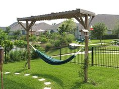 Back yard hammock designs!!!  My hubby wants a hammock.  With no big trees this might be good?