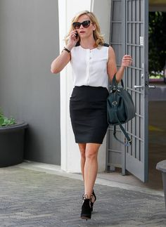 Reese Witherspoon in a ladylike fall top, pencil skirt, and booties