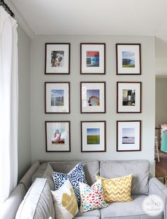 By identical frames and mats and fill them full of photos