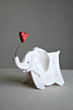 I'd like to try this with model magic head with plaster wrap body....Small elephant sculpture with imprinted words of by Dprintsclayful.....might be fun to try in polymer clay